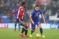 Romaine Sawyers of Brentford is tackled by Craig Bryson of Cardiff City during the Sky Bet Championship match between Cardiff City and Brentford at the Cardiff City Stadium, Wales, UK. Saturday 18 November 2017