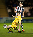AYR UNITED'S EDDIE MALLONE CHALLENGES GARY TEALE.