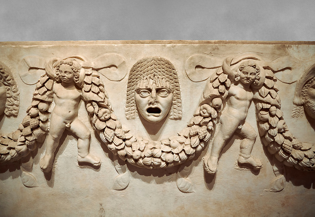 """Close up picture of Roman relief sculpted Sarcophagus of Garlands, 2nd century AD, Perge. This type of sarcophagus is described as a """"Pamphylia Type Sarcophagus"""". It is known that these sarcophagi garlanded tombs originated in Perge and manufactured in the sculptural workshops of Perge. Antalya Archaeology Museum, Turkey."""