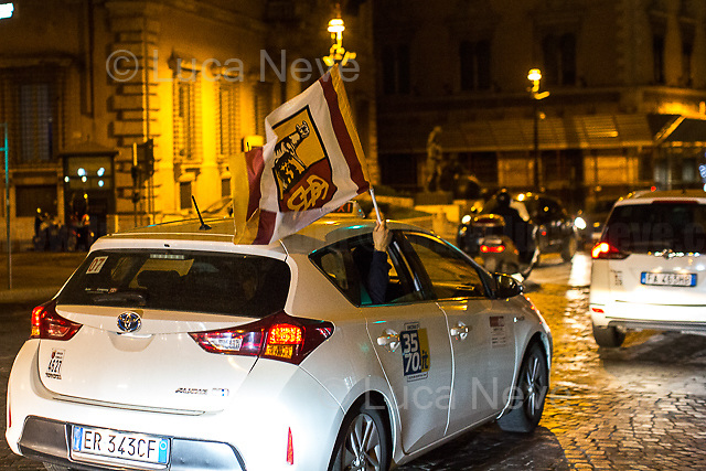 Roma's supporter.<br /> <br /> Rome, 02/05/2018. Following and documenting a group of Liverpool F.C. supporters chanting and cheering on throughout the streets of central Rome while waiting for the Champions League Semi-final (second leg) at the Stadio Olimpico versus A.S. Roma. The supporters were escorted by heavy presence of the Italian Police and Carabinieri, assisted by Merseyside Police's officers (British Police) and by the stewards and staff from Liverpool Football Club. Last week, during the first leg of the semi-final in Liverpool, an English fan was attacked by Italian supporters outside Anfield stadium. However, the day of the match in Rome passed without any serious incidents involving supporters and just one arrest - a Liverpool supporter - was made (on suspicion of common assault and a public order offence). The actual match was played in the evening and saw Liverpool losing 4-2 but due to the aggregate with the first match, 7-6, the &quot;Reds&quot; conquered the access to the Champions League final in Kiev against Real Madrid. A statement from the English club read: &quot;Liverpool would like to thank all supporters who travelled to Rome for Wednesday evening's Champions League meeting with Roma at Stadio Olimpico for their exemplary conduct. Over 5,000 fans made the journey to the Italian capital for yesterday's semi-final second leg, behaving impeccably throughout, with no major incidents reported. LFC also acknowledges the significant resources deployed by Roma, UEFA, Merseyside police, Italian police and security services in Rome to ensure all fans enjoyed a safe visit.&quot;<br /> <br /> For more info about the football teams please click here: http://www.asroma.com/en &amp; http://www.liverpoolfc.com/