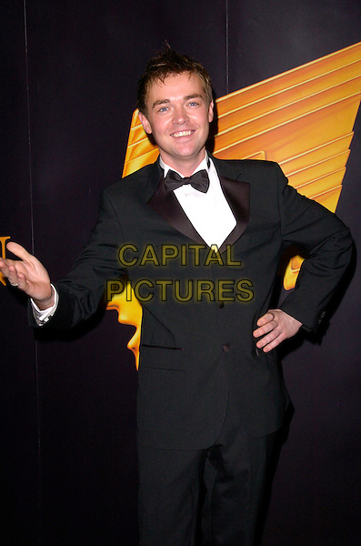 STEPHEN MULHERN.Inside Arrivals at the RTS Programme Awards, .Grosvenor House Hotel, Park Lane, London, England, March 13th 2007..full length black tuxedo bow tie hand on hip funny steven.CAP/CAN.©Can Nguyen/Capital Pictures
