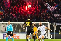 27th February 2020; St Jakob Park, Basel, Switzerland; UEFA Europa League Football, FC Basel versus APOEL Nicosia; Giorgos Merkis of APOEL Nicosia clears with a header above Arthur Cabral of FC Basel