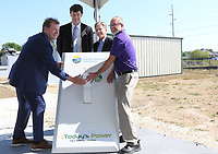 NWA Democrat-Gazette/DAVID GOTTSCHALK  Mitchell Johnson (from left), president and chief executive officer Ozarks Electric Cooperative, Ted Thomas, chairman of the Arkansas Public Service Commission, Michael Henderson, president Today's Power, and Fayetteville Mayor Lioneld Jordan flip a ceremonial switch Friday, September 6, 2019, for the new solar array at the Westside Wastewater Treatment Plant during a flipping the switch ceremony in Fayetteville. The city of Fayetteville, Ozarks Electric Cooperative and Today's Power, Inc. partnered to bring the 10-megawatt solar system with 24 megawatt-hours of on-site energy storage to the city's two wastewater treatment plants.