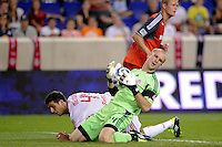 Toronto FC goalkeeper Stefan Frei (24) recovers a ball after colliding with Carlos Mendes (44) of the New York Red Bulls. The New York Red Bulls defeated Toronto FC 5-0 during a Major League Soccer (MLS) match at Red Bull Arena in Harrison, NJ, on July 06, 2011.