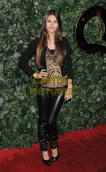 VICTORIA JUSTICE .The QVC Red Carpet Style Party held at the Four Seasons Hotel Los Angeles in Los Angeles, California, USA..February 25th, 20111.full length black leather trousers jacket brown beige leopard print top hand on hip.CAP/ROT/TM.©Tony Michaels/Roth Stock/Capital Pictures