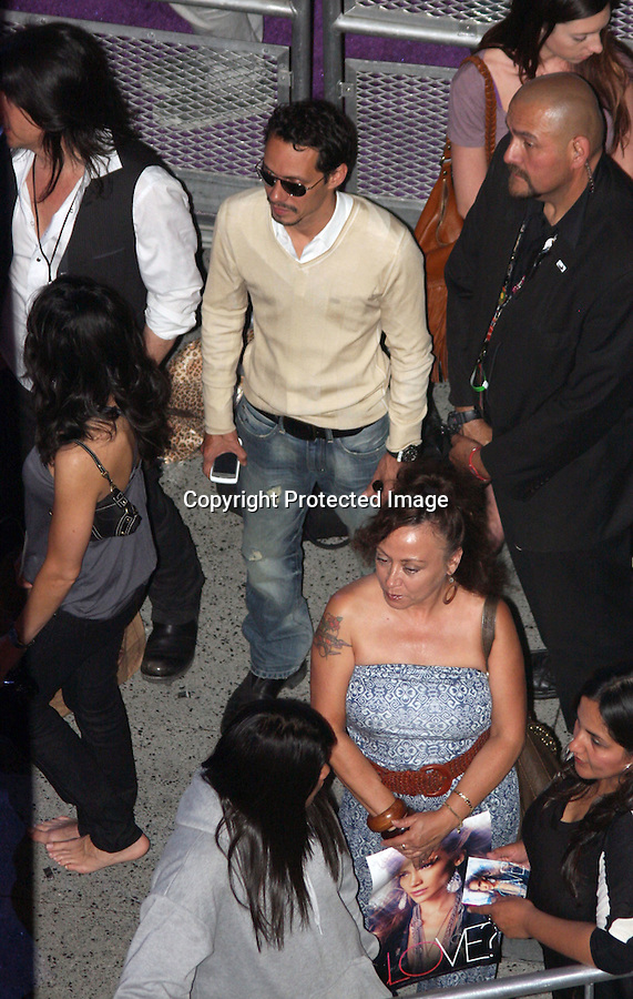 May 3rd 2011 ..Marc Anthony was drinking beer & flirting with girls while Jennifer was signing autographs. Marc kept one of his hands deep in his pocket while drinking & smoking cigarettes talking with a lady who wasn't wearing shoes .Jennifer Lopez aka JLO signing autographs & taking pictures with fans at the Hard Rock Café restaurant in Hollywood California. JLO was hugging fans wearing black leather boots & a all black out fit waving and smiling at the crowd with Marc Anthony ...AbilityFilms@yahoo.com.805-427-3519.www.AbilityFilms.com