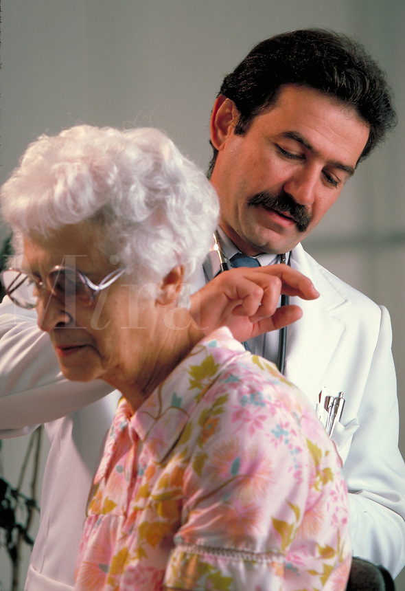Doctor performing percussion measure on elderly, senior, female patient, occupations, medical, health care.