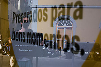 LISBON, PORTUGAL - MAY 21: Participants in the protest are seen holding banners reflected on a glass standing up in the street in front of the Portuguese Parlament in a protest with social distancing rules in Lisbon, on May 21, 2020. <br /> Professionals in the sector will express their indignation at the conditions in which they currently live, demand urgent and immediate support and legislation that will define once and for all the status of the intermittent artist. (Photo by Luis Boza/VIEWpress)