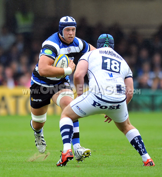 Dave Attwood goes on the charge. Pre-season friendly match, between Bath Rugby and Bristol Rugby on August 17, 2013 at the Recreation Ground in Bath, England. Photo by: Patrick Khachfe / Onside Images