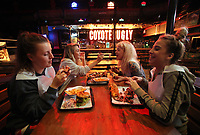 Pictured: Customers enjoy food. Monday 15 May 2017<br /> Re: Coyote Ugly Saloon in Cardiff, Wales, UK.