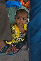 Child at the Varanasi Train Station, India