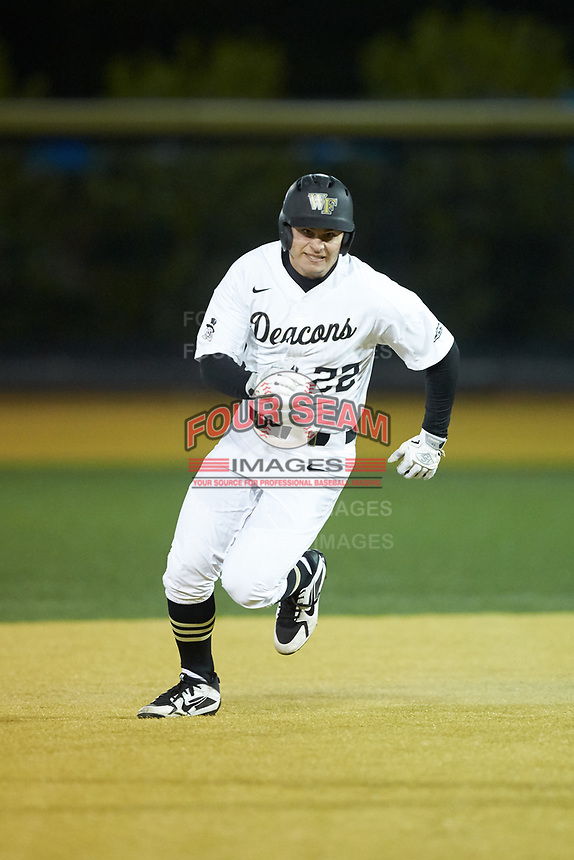 Michael Ludowig (22) of the Wake Forest Demon Deacons hustles towards third base against the Florida State Seminoles at David F. Couch Ballpark on March 9, 2018 in  Winston-Salem, North Carolina.  The Seminoles defeated the Demon Deacons 7-3.  (Brian Westerholt/Four Seam Images)