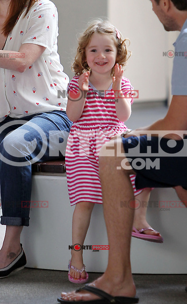 """Is that a Robot-Dance? Alyson Hannigan and hubby Alexis Denisof crack up while little Satyana horses around during a shopping break at the Santa Monica mall. Baby Keeva_was sleeping in the stroller while Alyson and Alexis talked about the newly purchased cute baby romper with the """"i'm going back to CALI"""" print. Notice Alyson's trendy cupcake-print blouse! Los Angeles, California on 3.8.2012..Credit: Correa/face to face.. / Mediapunchinc  ***online only for the weekly magazines***** /NortePhoto.com<br /> <br />  **CREDITO*OBLIGATORIO** *No*Venta*A*Terceros*<br /> *No*Sale*So*third* ***No*Se*Permite*Hacer Archivo***No*Sale*So*third*"""