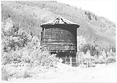 South side view of the RGS Rico water tank long after abandonment and after the chainlink fence had appeared.<br /> RGS  Rico, CO