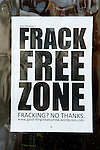 Balcombe West Sussex UK. Frack Free Zone sign in shop window in village.