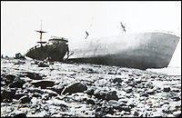 BNPS.co.uk (01202 558833)<br /> Pic: BNPS<br /> <br /> A shipwreck at Ostend.<br /> <br /> Haunting photos which capture the trail of devastation left in the wake of the Dunkirk evacuation have been unearthed after 77 years.<br /> <br /> The poignant pictures were taken soon after 330,000 Allied troops had been rescued from the beaches by an armada of little ships having been defeated by the Germans.<br /> <br /> The epic operation is about to be the subject of the new Hollywood blockbuster movie 'Dunkirk' will stars Tom Hardy and Harry Styles and is die for release on July 21.<br /> <br /> The black and white snaps show German soldiers surveying the wreckage which included destroyed ships and large military trucks lying in the surf.<br /> <br /> They are being sold by Duke's Auctioneers.