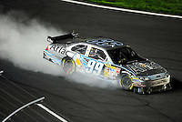 Oct. 17, 2009; Concord, NC, USA; NASCAR Sprint Cup Series driver Carl Edwards blows an engine during the NASCAR Banking 500 at Lowes Motor Speedway. Mandatory Credit: Mark J. Rebilas-