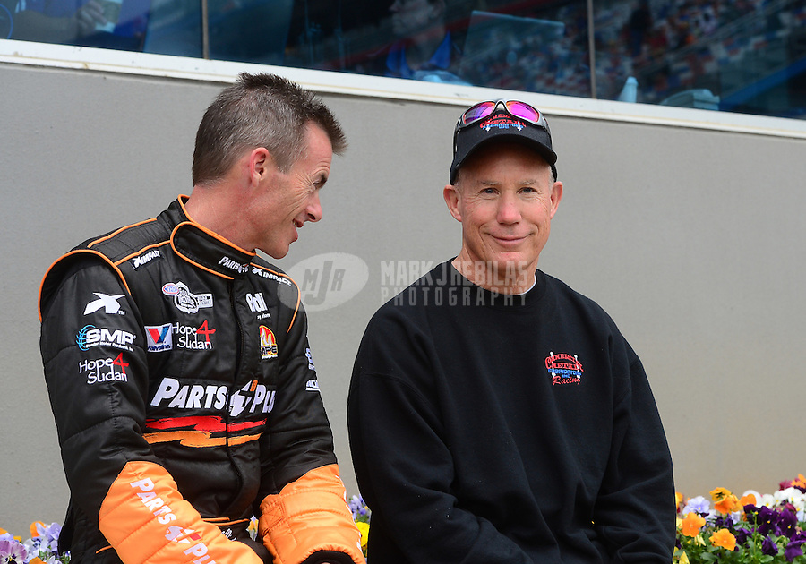 Apr. 15, 2012; Concord, NC, USA: NHRA top fuel dragster driver Pat Dakin (right) talks with Clay Millican during eliminations for the Four Wide Nationals at zMax Dragway. Mandatory Credit: Mark J. Rebilas-