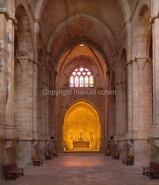 Nave of the Abbey Church of<br /> Fontfroide Abbey or l'Abbaye Sainte-Marie de Fontfroide, Narbonne, Languedoc-Roussillon, France. Founded by the Viscount of Narbonne in 1093, Fontfroide linked to the Cistercian order in 1145. The church has a traditional basilical latin cross plan and a 20m high vaulted ceiling. Picture by Manuel Cohen