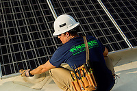 Charlotte solar and wind installation firm Argand Energy Solutions is helping companies use green energy by installing solar panels atop their buildings, including this rooftop in the 1900 block of south Tryon St. Argand Energy installs solar electric, wind energy and solar hot water systems throughout North and South Carolina. North Carolina was the first state in the Southeast to require utilities to use renewable energy in generating electricity. NC residents and businesses that invest in renewable power may receive tax credits.