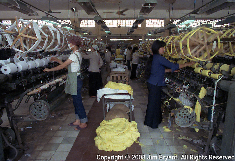 Workers work at textile weaving machines at a towel factory in Hanoi. Jim Bryant Photo....