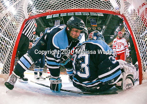 Brian Flynn (Maine - 10), Dave Wilson (Maine - 33), Vinny Saponari (BU - 27) - The University of Maine Black Bears defeated the Boston University Terriers 5-2 (EN) on Friday, March 19, 2010, in their Hockey East championship semi-final at the TD Garden in Boston, Massachusetts.