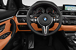 Car pictures of steering wheel view of a 2018 BMW M4 Base 2 Door Convertible