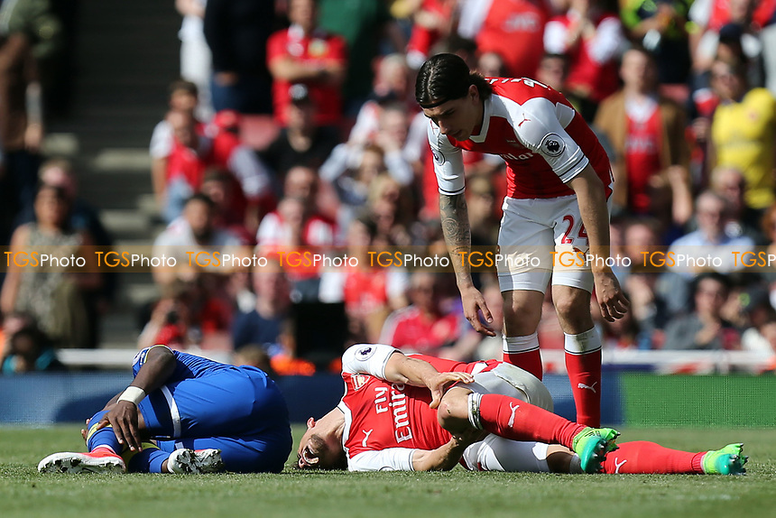 Gabriel Paulista of Arsenal  and Enner Valencia of Everton lie injured during Arsenal vs Everton, Premier League Football at the Emirates Stadium on 21st May 2017