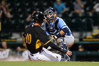 Charlotte Stone Crabs catcher Armando Araiza (19) tags out JaCoby Jones (10) sliding into home during a game against the Bradenton Marauders on April 22, 2015 at McKechnie Field in Bradenton, Florida.  Bradenton defeated Charlotte 7-6.  (Mike Janes/Four Seam Images)