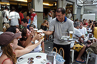 People drinking chope ( draught beer ) at Bracarense Bar served by famous carioca waiter Chico Gomes, Leblon district, Rio de Janeiro lifestyle, Brazil. Chico leaved Bracarense a year after this photo was taken.