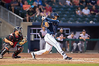 Northwest Arkansas Naturals outfielder Anderson Miller (4) connects on a pitch during a Texas League game between the Northwest Arkansas Naturals and the Arkansas Travelers on May 30, 2019 at Arvest Ballpark in Springdale, Arkansas. (Jason Ivester/Four Seam Images)
