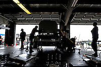 Aug. 8, 2009; Watkins Glen, NY, USA; Crew members work on the car driven by NASCAR Sprint Cup Series driver P.J. Jones in the garage during practice for the Heluva Good at the Glen. Mandatory Credit: Mark J. Rebilas-