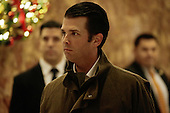 Donald Trump Jr. walks through the lobby of Trump Tower, in New York, New York, USA, 02 January 2017. <br /> Credit: Peter Foley / Pool via CNP
