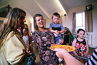 Pictured: Local familes are given hot food at St Teilo Church in Clase, Swansea, UK. Friday 25 August 2017<br /> Re: Free food for children story, Swansea, Wales, UK.