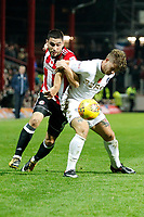 Neal Maupay of Brentford tussles with Gaetano Berardi of Leeds United during the Sky Bet Championship match between Brentford and Leeds United at Griffin Park, London, England on 4 November 2017. Photo by Carlton Myrie.