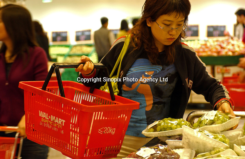 A lady buys grapes at a Wal-mart superstore in the center of Kunming, capital of Yunnan Province, China. An Introduction to Wal-Mart. In 1996, Wal-Mart entered the Chinese market nowadays operate 45 units in 21 cities across the mainland. The American retailer is very popular and is responsible for the closure of many local  traditional markets..08 Jul 2005
