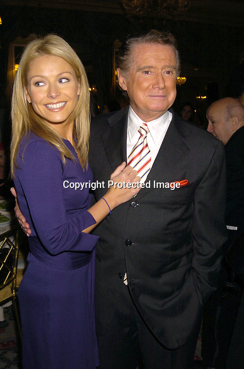 Kelly Ripa and Regis Philbin ..at the PAL 16th Annual Women of the Year Luncheon honoring Kelly Ripa, Paul Zahn and Cindi Stivers on October 26, 2004 at the Pierre Hotel. ..Photo by Robin Platzer, Twin Images