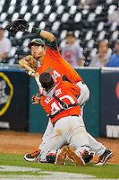 Miami Hurricanes catcher Garrett Kennedy #40 collides with first baseman Esteban Tresgallo #14 as they pursue a foul pop fly during the game against the Wake Forest Demon Deacons at NewBridge Bank Park on May 25, 2012 in Winston-Salem, North Carolina.  The Hurricanes defeated the Demon Deacons 6-3.  (Brian Westerholt/Four Seam Images)
