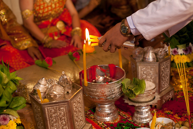 Candle lighting during a buddhist wedding in a small village outside of Phnom Penh, Cambodia. <br /> <br /> Photos &copy; Dennis Drenner 2013.