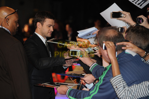 Justin Timberlake.'In Time' UK premiere at the Curzon, Mayfair, London, England..31st October 2011.half length signing autographs white shirt stubble facial hair black suit shirt grey gray fans crowd side profile .CAP/WIZ.© Wizard/Capital Pictures.