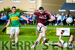 Thomas Curran of Dromid Pearses drives the ball after breaking free of Stephen O'Sullivan of Skellig Rangers in the Junior Premier Football Championship Semi Final in Cahersiveen.