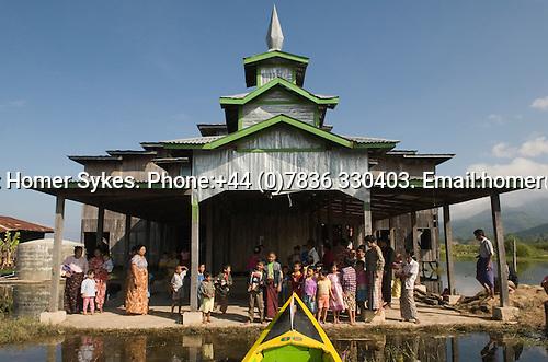Inle Lake. Myanmar (Burma.) 2006. Village monastery, villagers say good bye to European visitors.