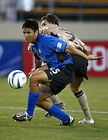 12 May 2004:  Brian Ching dribbles the ball away from Portugal defender at Spartan Stadium in San Jose, California.  Earthquakes defeated Sporting Club of Portugal, 4-1..Mandatory Credit: Michael Pimentel/ISI