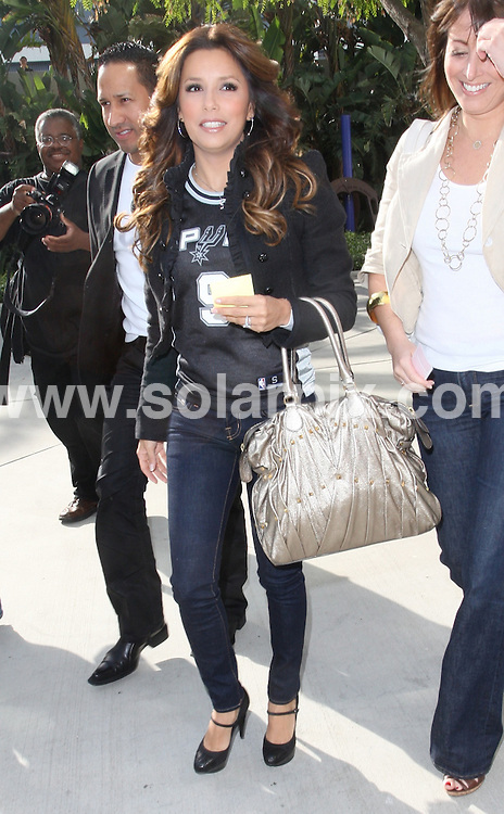 **ALL ROUND PICTURES FROM SOLARPIX.COM**.**WORLDWIDE SYNDICATION RIGHTS - NO USA**.Eva Longoria Parker went to the Staples Center with a friend to support her basketball playing husband Tony Parker. Tony plays for the San Antonio Spurs who played the Los Angeles Lakers. Eva wore Tony's jersey to the game. 21st May 2008..JOB REF: 6484 RYA        DATE: 21_05_2008.**MUST CREDIT SOLARPIX.COM OR DOUBLE FEE WILL BE CHARGED* *UNDER NO CIRCUMSTANCES IS THIS IMAGE TO BE REPRODUCED FOR ANY ONLINE EDITION WITHOUT PRIOR PERMISSION*