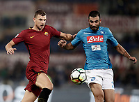 Calcio, Serie A: Roma, stadio Olimpico, 14 ottobre 2017.<br /> Napoli's Raul Albiol (r) in action with Roma's Edin Dzeko (i) during the Italian Serie A football match between Roma and Napoli at Rome's Olympic stadium, October14, 2017.<br /> UPDATE IMAGES PRESS/Isabella Bonotto