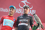Andrea Guardini (ITA) Astana wins Stage 1, The ADNOC Stage, and dons the race leader's Red Jersey pictured with Paul Voss Black Points Jersey wearer of Bora-Argon 18 on the podium, of the 2015 Abu Dhabi Tour, running 174 km from Qasr Al Sarab to Madinat Zayed, Abu Dhabi. 8th October 2015.<br /> Picture: ANSA/Angelo Carconi | Newsfile