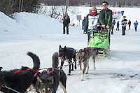 Denver Kay Evans and Ryan Redington take the team to the dog lot at the finish line of the 2016 Junior Iditarod in Willow, Alaska, AK  February 28, 2016