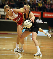 25.10.2012 Silver Ferns Laura Langman and England's Sara Bayman in action during the Silver Ferns v England netball test match as part of the Quad Series played at the TSB Arena Wellington. Mandatory Photo Credit ©Michael Bradley.