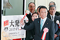 Taro Aso, Minister of Finance and Deputy Prime Minister, poses for cameras during the New Year opening ceremony for the Tokyo Stock Exchange (TSE) on January 4, 2017, Tokyo Japan. The Nikkei Stock Index opened at 19,298.68, higher than the last trading day of 2016. (Photo by Rodrigo Reyes Marin/AFLO)