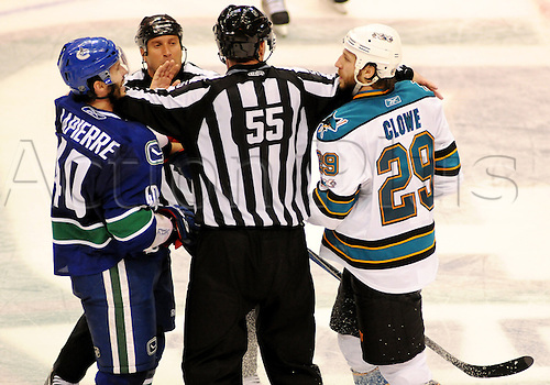 18.05.2011 Linesman Shane Heyer (55) seperates Vancouver Canucks center Maxim Lapierre (40) and San Jose Sharks forward Ryane Clowe (29) in the third period during game 2 of the Western Conference Finals  in Vancouver, British Columbia on Wednesday night.   The Canucks beat the Sharks 7 - 3.